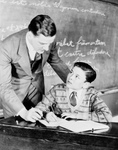 Free Picture of Teacher Helping a Student
