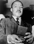 Free Picture of MLK Holding a Medallion