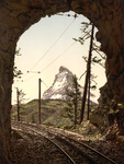Free Picture of Train Tracks in a Tunnel and Matterhorn Mountain