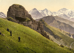 Free Picture of People on a Hillside Near the Swiss Alps Mountains