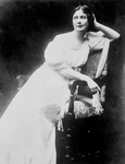 Free Picture of Isadora Duncan Seated in a White Dress