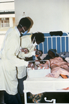 Free Picture of Doctors Giving Health Care to a Female Lassa Fever Patient in the Segbwema, Sierra Leone Clinic