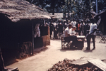 Free Picture of Person Issuing Ration Cards to African People in Port Harcourt, Nigeria During the Nigerian-Biafran War