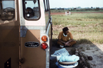 Free Picture of Patient with Ebola-like Symptoms Laying in the Back of a Land Rover