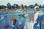 Free Picture of Fastening an Isolation Unit with a Suspected Ebola Patient - 1976