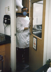 Free Picture of Virologist Entering a Biosafety Level-4 laboratory - 1975
