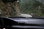 Driving Beside Rocky Cliff on an Oregon Highway