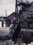 Photo of Riveter Women Wiping Trains in the Chicago and North Western Railroad, 1943