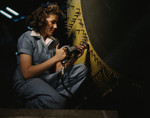 Stock Photo of a Riveter Woman Working on a Consolidated Bomber