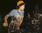 Photo of a Female Riveter Lathe Operator Machining Parts for Transport Planes