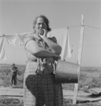 Woman Standing by Laundry Lines