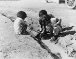 Children Playing in Ditch