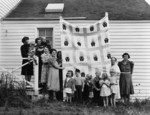 People Holding a Quilt