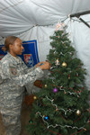 Army Sgt Decorating Christmas Tree