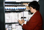 Person Standing In Front of a Drug Repository