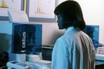Laboratory Technician Using a Cetus Propette to Collect Scientific Data - 1980