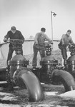 Men Operating Oil Valves