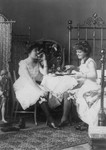Two Women Eating in Bedroom