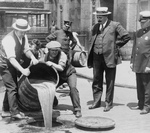 Men Pouring Liquor Into a Sewer During Prohibition