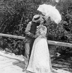 Man and Woman Kissing Under a Parasol