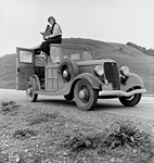 Dorothea Lange on Top of a Car