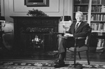 Jimmy Carter Sitting by a Fireplace