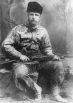 Theodore Roosevelt Holding a Rifle
