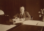 Theodore Roosevelt Sitting at Desk