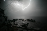 Lightning Near Aircraft Carrier