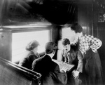 Men Playing Chess on a Train