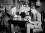 Men Playing a Game of Chess