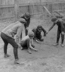 Boys Playing a Game of Marbles