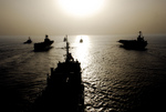 Military Ships at Sunset