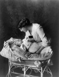 Ethel Barrymore Putting a Baby in a Crib