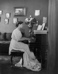 Ethel Barrymore Playing a Piano
