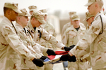 Honor Guardsmen Folding a Flag