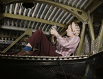 Picture of a Woman Riveting an A-20 Bomber
