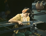 Picture of a Riveter Operating a Riveting Machine