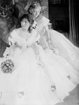 Two Women in Crinoline Ball Gowns