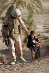 Soldier With an Iraqi Child