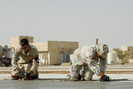 Soldiers Smoothing Cement