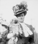 Woman Holding a Pekinese Dog