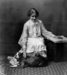 Helen Keller Reading Braille and Petting a Dog