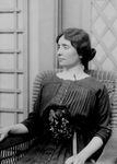 Helen Keller Sitting in a Chair