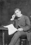 Booker Taliaferro Washington Reading a Newspaper
