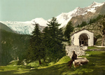 Man Seated Near a Chapel in the Swiss Alps