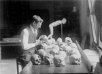 William H. Egberts Studying Skulls