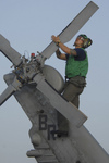 Soldier During Corrosion Maintenance on a Military Helicopter