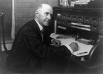 Eugene V Debs Working at a Desk