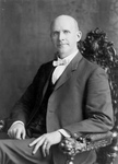 Eugene Debs Sitting in a Chair